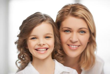 bright closeup picture of mother and daughter Stock Photo