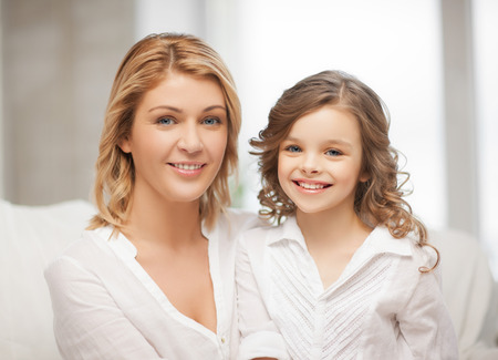 pre teen girls: bright closeup picture of mother and daughter Stock Photo