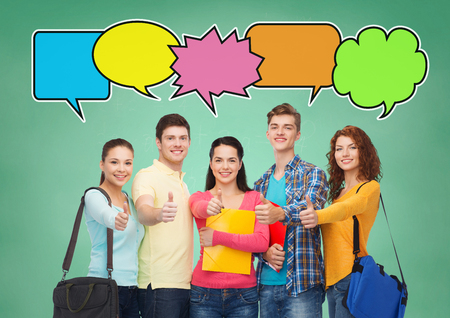 group of young people: school, education, communication, gesture and people concept - group of smiling students with folders and school bags showing thumbs up over green board background with text bubbles