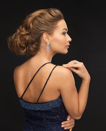 ear ring: beautiful woman in evening dress wearing diamond earrings