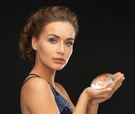 beautiful woman in evening dress with big diamond photo