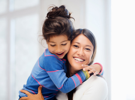 asian mother and daughter: family, children and happy people concept - hugging mother and daughter Stock Photo