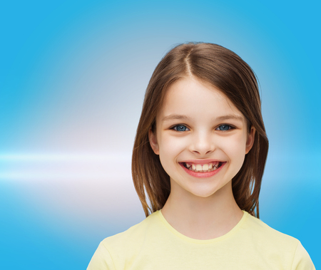 beautiful preteen girl: happiness and people concept - smiling little girl over white background