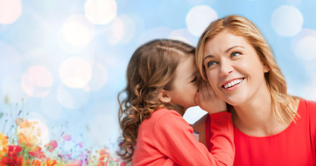 trust people: people, trust, love, family and motherhood concept - happy daughter whispering gossip to her mother over blue lights and poppy field background
