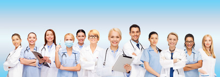 group: healthcare, technology and medicine concept - smiling female doctors and nurses with tablet pc computer