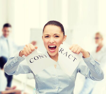 break the rules: business, documents, people, legal and real estate concept - serious businesswoman tearing contract Stock Photo