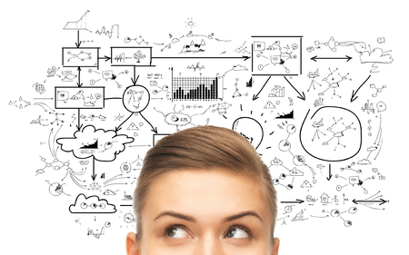 woman looking up: planning, business and people concept - close up of woman looking up to scheme or plan Stock Photo