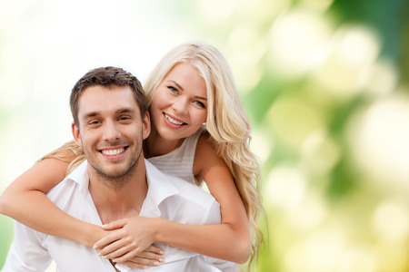 summer holiday, vacation, dating and love concept - happy couple having fun over green background photo