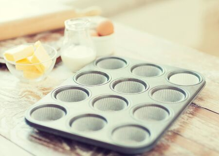 cooking and home concept - close up of empty muffins molds photo