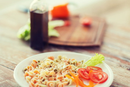 close up food: cooking, food and home concept - close up of pasta meal on plate Stock Photo