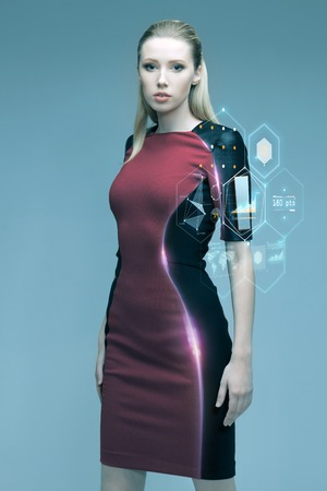 projection: people, future technology and science concept - beautiful futuristic woman with virtual projection over gray background