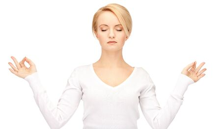 bright picture of woman in meditation over white. photo