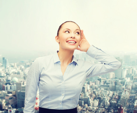 blab: business, office and gossip concept - smiling businesswoman listening gossig outdoors