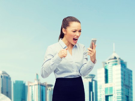 business, technology and education concept - screaming businesswoman with smartphone outside photo