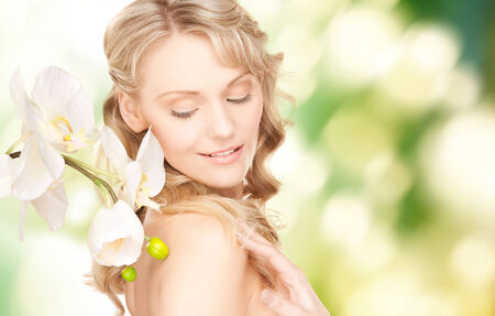 beauty and people concept - face of beautiful young woman over green background photo
