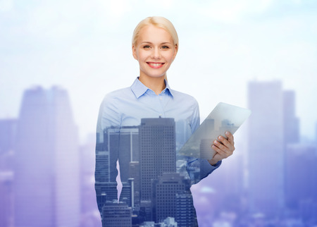 business, people and technology concept - smiling businesswoman with tablet pc computer over city background photo