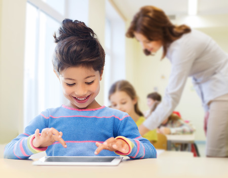 internet education: education, elementary school, technology and children concept - happy little student girl with tablet pc over classroom and teacher background
