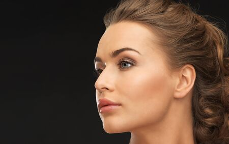 woman black background: face of beautiful beautiful woman over black background Stock Photo