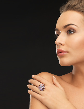 beautiful woman in evening dress with cocktail ring photo
