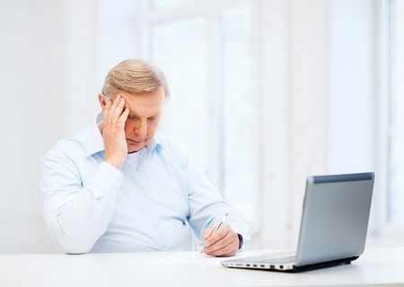 school form: business, tax, office, school and education concept - old man filling a form at home
