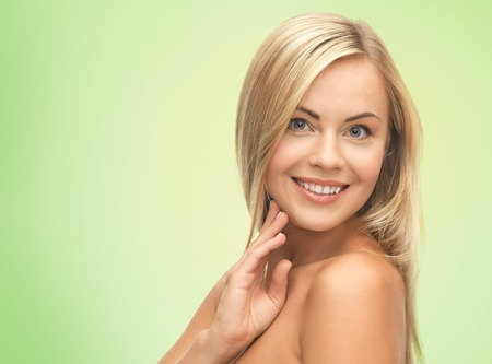 nice body: people, beauty, body and skin care concept - beautiful woman face and hands over green background