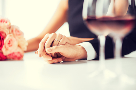 occasion: picture of engaged couple with wine glasses in restaurant Stock Photo