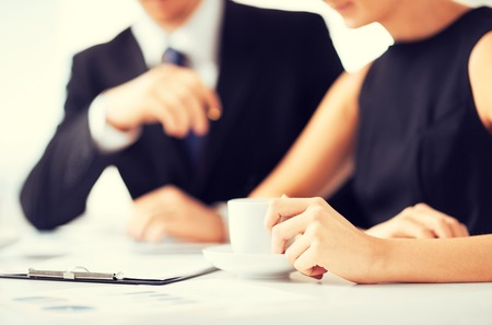 businessman signing documents: picture of woman hand signing contract paper