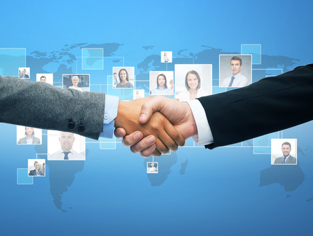 business hand shake: business and office concept - businessman and businesswoman shaking hands