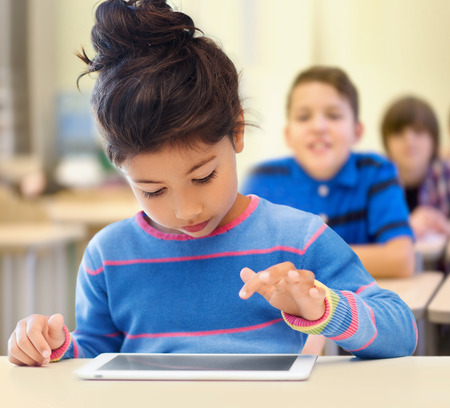 latin kids: education, elementary school, technology and children concept - little student girl with tablet pc over classroom and classmates background