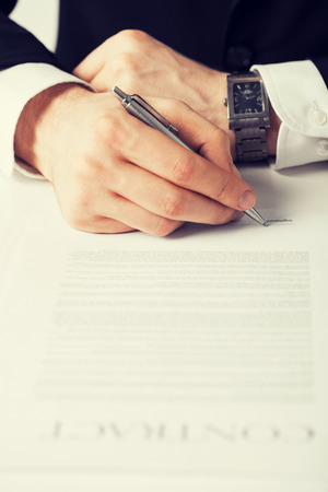 new contract: picture of man hands signing contract