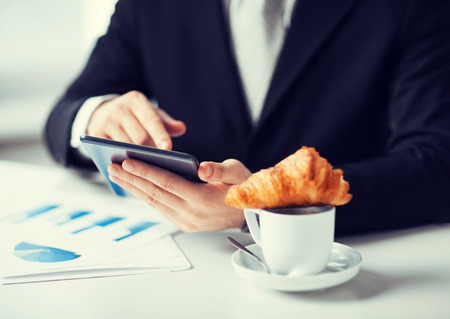 close up of man with tablet pc and cup of coffee photo