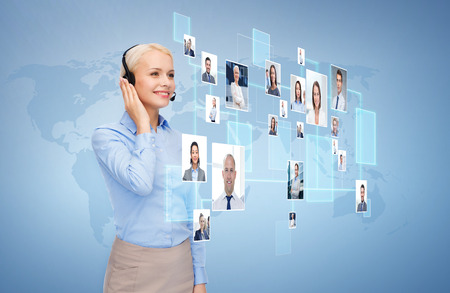 business, communication, cooperation and people concept - happy female helpline operator with headset over blue background and icons of contacts or customers Stockfoto