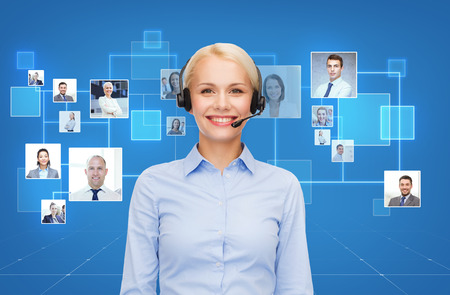 business communication: business, communication, cooperation and people concept - happy female helpline operator with headset over blue background and icons of contacts or customers Stock Photo