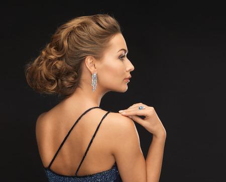 ear rings: beautiful woman in evening dress wearing diamond earrings
