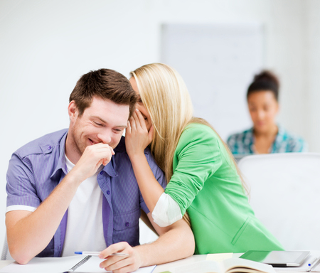 joking: education concept - group of students gossiping at school Stock Photo