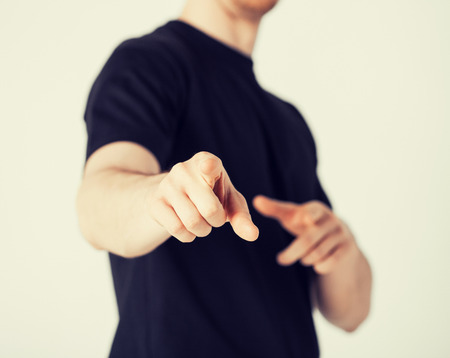 close up of man pointing his finger at you photo