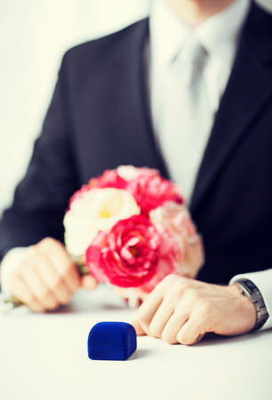 picture of man with gift box in suit photo