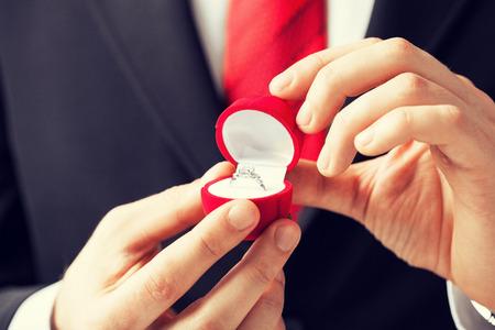 proposal: man making proposal with wedding ring and gift box.