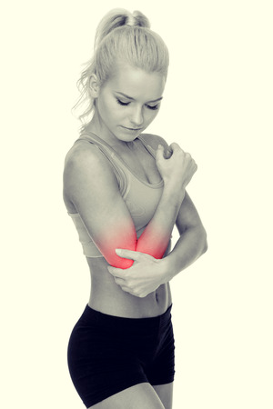 rupture: healthcare, fitness and medicine - sporty woman with pain in elbow Stock Photo