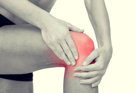 arthritis knee: fitness, healthcare and medicine concept - close up of female hands holding knee Stock Photo