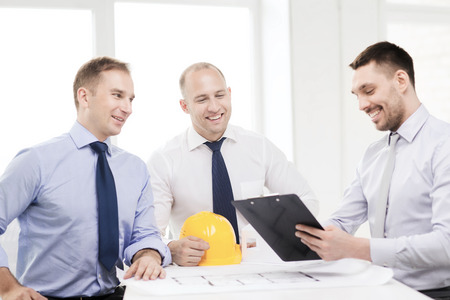 constructors: business, architecture and office concept - happy team of architects and designers in office Stock Photo
