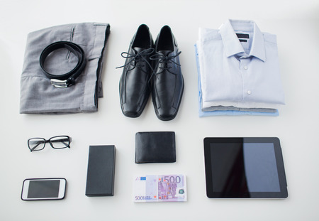 business style: business, style, clothes and objects concept - close up of formal male clothes and personal stuff on table at home