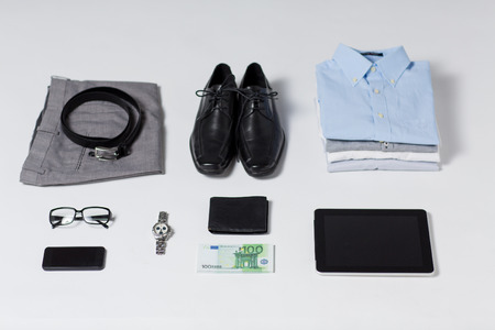 stuff: business, style, clothes and objects concept - close up of formal male clothes and personal stuff on table at home