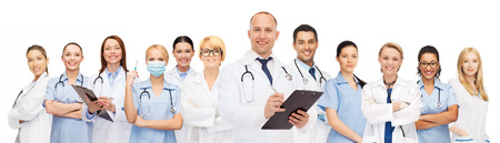 doctors smiling: medicine, profession, teamwork and healthcare concept - international group of smiling medics or doctors with clipboard and stethoscopes over white background