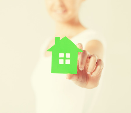 closeup picture of woman hands holding green house photo