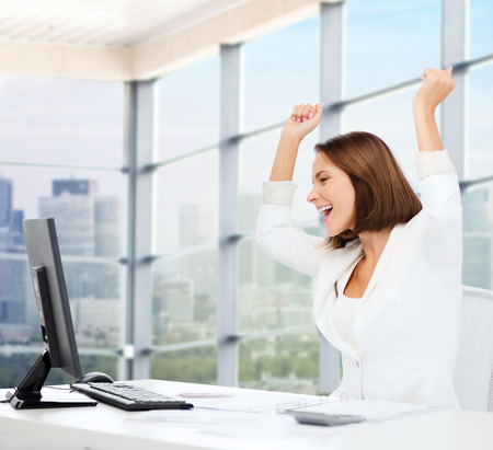 passed: business, triumph, people and education concept - happy businesswoman with computer and raised hands over office window background