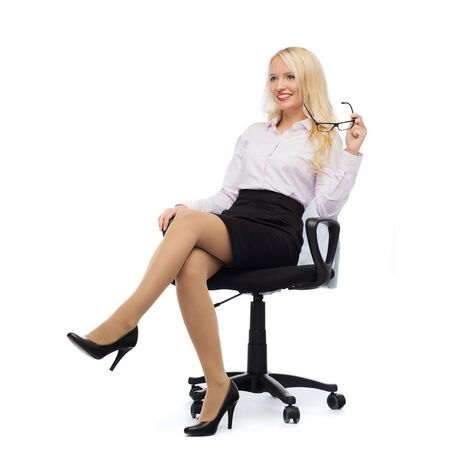 business, style and people concept - smiling businesswoman, student or secretary over white background photo