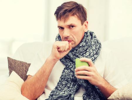 tosiendo: salud y la medicina concepto - hombre enfermo con la gripe en casa