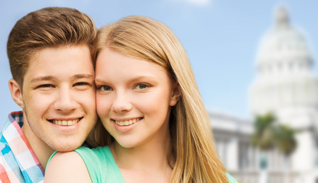 travel, tourism, vacation, people and love concept - smiling couple hugging over washington white house background photo