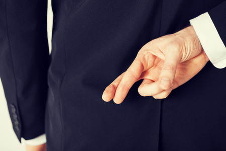 bright picture of man with crossed fingers Standard-Bild